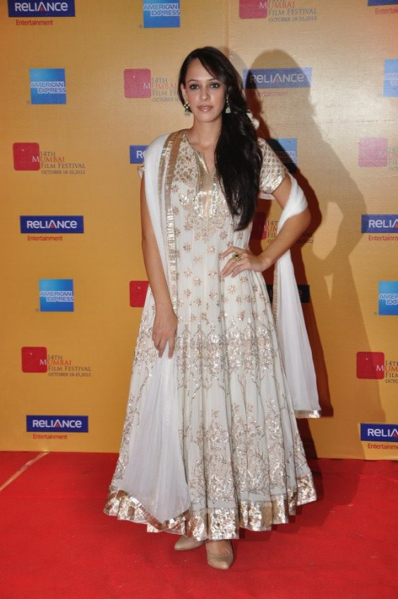 Hazel Keech in a white and gold Anita Dongre anarkali