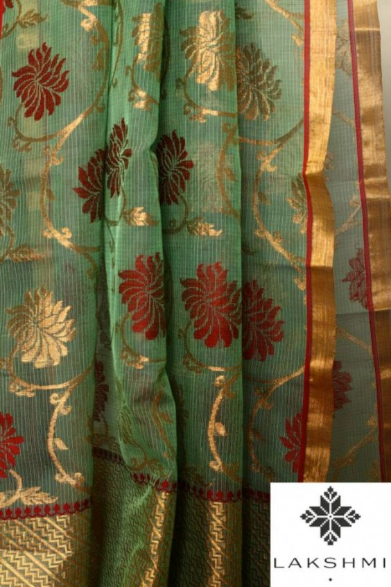Pure Zari Kota with an elaborate woven floral design